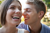 Happy Couple Laughing Outdoors — Stock Photo