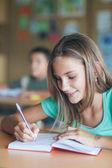 Schoolgirl Writing — Stock Photo