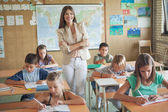 Smiling Teacher and Her Students — Stockfoto