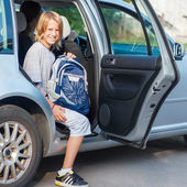 Schoolboy Getting out of the Car — Stock Photo