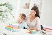 Mother and Daughter Doing Homework Together — Stockfoto