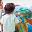 Stock Photo: Mother Teaching Her Boy About Earth