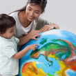 Stock Photo: Mother and Son Learning About Planet Earth