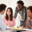 Stock Photo: Multiethnic Group of College Students Studying Together
