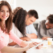 Smiling College Students Sitting Together — Stock Photo #34745955