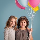Girls Holding Balloons — Stock Photo