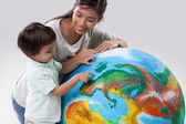 Mother and Son Learning About Planet Earth — Photo