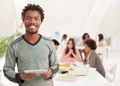 Smiling African College Student With a Tablet — Stock Photo