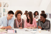 Smiling College Students Sitting Together — Stock Photo