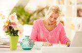 Smiling businesswoman working at home. — Stock Photo