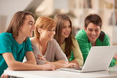 Smiling Teenagers Using a Laptop — Stock Photo