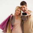 Couple With Shopping Bags Making a Self-Portrait — Stock Photo