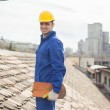 Construction Worker Holding a Tile on the Rooftop — Stock Photo