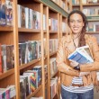Stock Photo: African Woman at a Book Shop