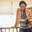 African American Woman Reading a Book at the Library — Stock Photo