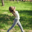 Young Caucasian Woman Doing Yoga Outdoors — Stock Photo #34754897