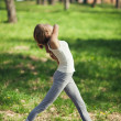 Stock Photo: Young Caucasian Woman Doing Yoga Outdoors