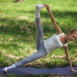 Young Caucasian Woman Doing Yoga Outdoors — Lizenzfreies Foto