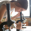 Biology Lesson: Girl Using a Microscope — Stock Photo #34755505