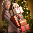 Woman Holding Christmas Presents — Stock Photo #34755781