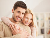 Smiling Couple in Their Living Room — Stock Photo