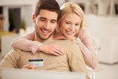 Smiling Couple Shopping Online — Stock Photo