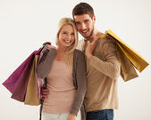 Smiling Couple Holding Shopping Bags — Stock Photo