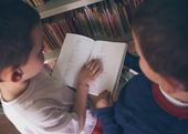 Boys Reading a Book at the Library — Stock Photo