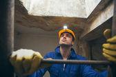 Construction Worker Climbing a Ladder — Stock Photo