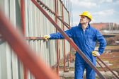 Builder Standing by a Metal Construction — Stock Photo
