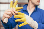 Builder Taking Off Protective Gloves — Stock Photo