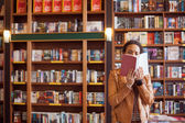 Woman Reading at a Book Shop — Stock Photo