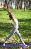 Young Caucasian Woman Doing Yoga Outdoors — Stock Photo
