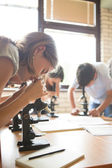 Biology Lesson: Students Looking Through Microscopes — Stock Photo