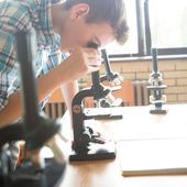 Biology Lesson: Boy Using a Microscope — Stock Photo