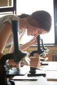 Biology Lesson: Girl Using a Microscope — Stock Photo