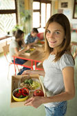 Girl Holding the Lunch Tray at School — Stock Photo
