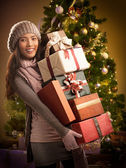 Woman Holding Christmas Presents — Stockfoto