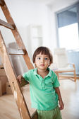 Boy Standing by a Ladder — Stock Photo