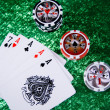 Stock Photo: Five playing cards and three stacks chips