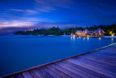 Pier at night Maldives — Stockfoto