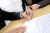 Business people with contract — Stock Photo