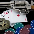 Close up of Peacemaker, Marshal Badge, Chips and  playing cards — Stock Photo
