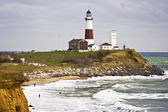 Montauk Point Lighthouse and two fishermen — Stock Photo
