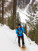 Young Woman Snowshoeing in South Tyrol — Stock Photo