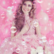 Beautiful girl in a pink princess costume with a teddy bear — Stock Photo
