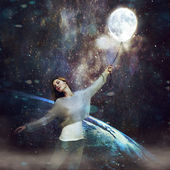 Beautiful girl with balloon, floating above the ground in outer space — Stock Photo