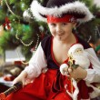 Little boy dressed as pirate near a christmas tree — Stock Photo