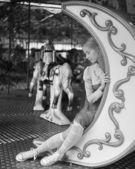 Girl posing on carousel — Foto Stock