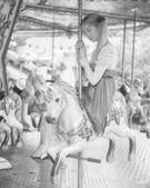 Girl posing on carousel — Stock Photo